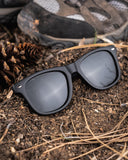 Black frame sunglasses with silver accents on the hiking trail