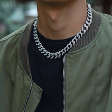 Load image into Gallery viewer, male model wearing white gold or silver cuban link chain for mens jewelry