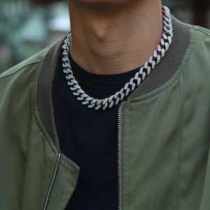 male model wearing white gold or silver cuban link chain for mens jewelry
