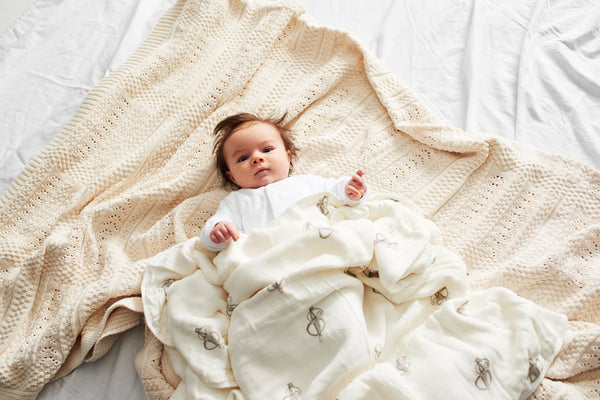 Baby Snuggled in Matchstick Monkey Blanket