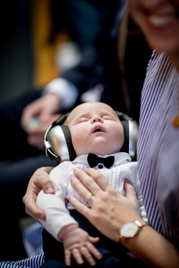 Baby wearing ear defenders