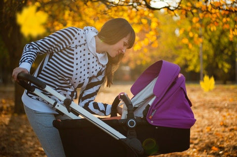 Mother with Baby in Pushchair