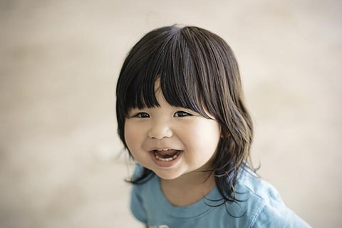 Smiling toddler with healthy teeth