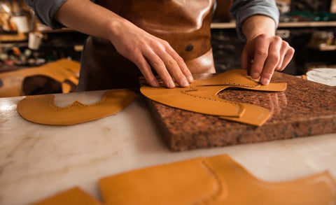 a man making a design in leather