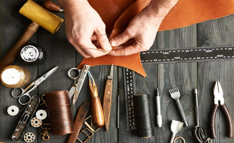 a man trying a piece of leather