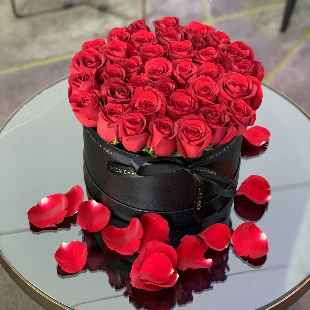 Red roses arrangement in a medium luxury round box - Upscale and Posh - Same Day Flower Delivery Dubai