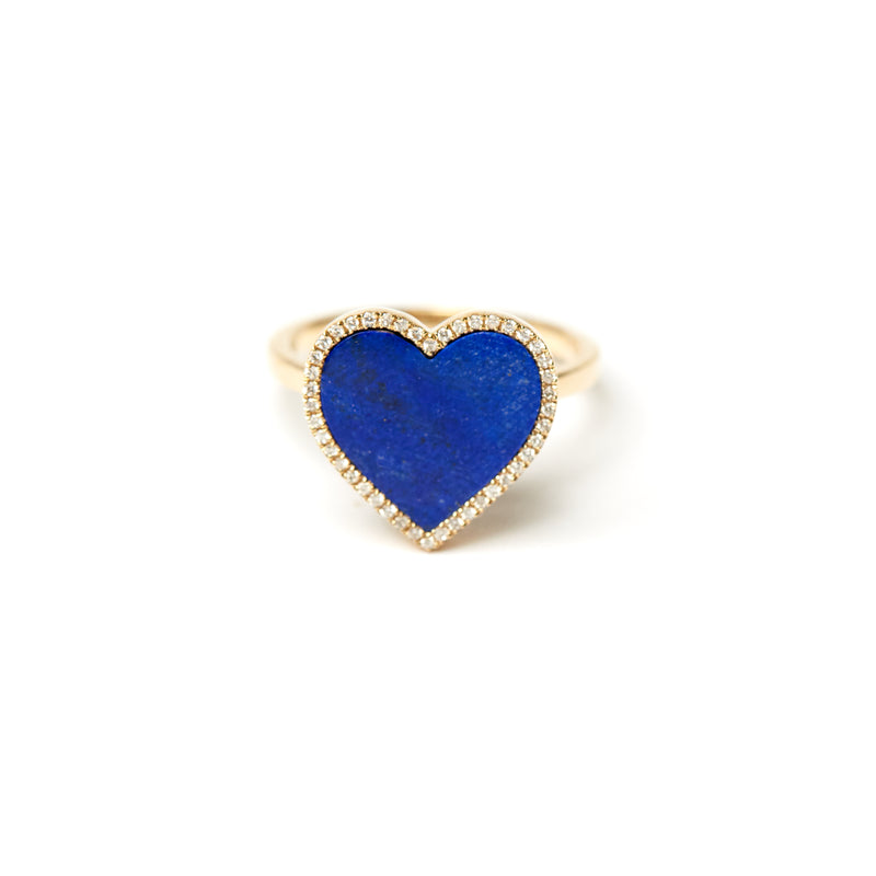 Heart shaped 14 karat lapis heart ring. The hand cut lapis heart is surrounded by pave diamonds.
