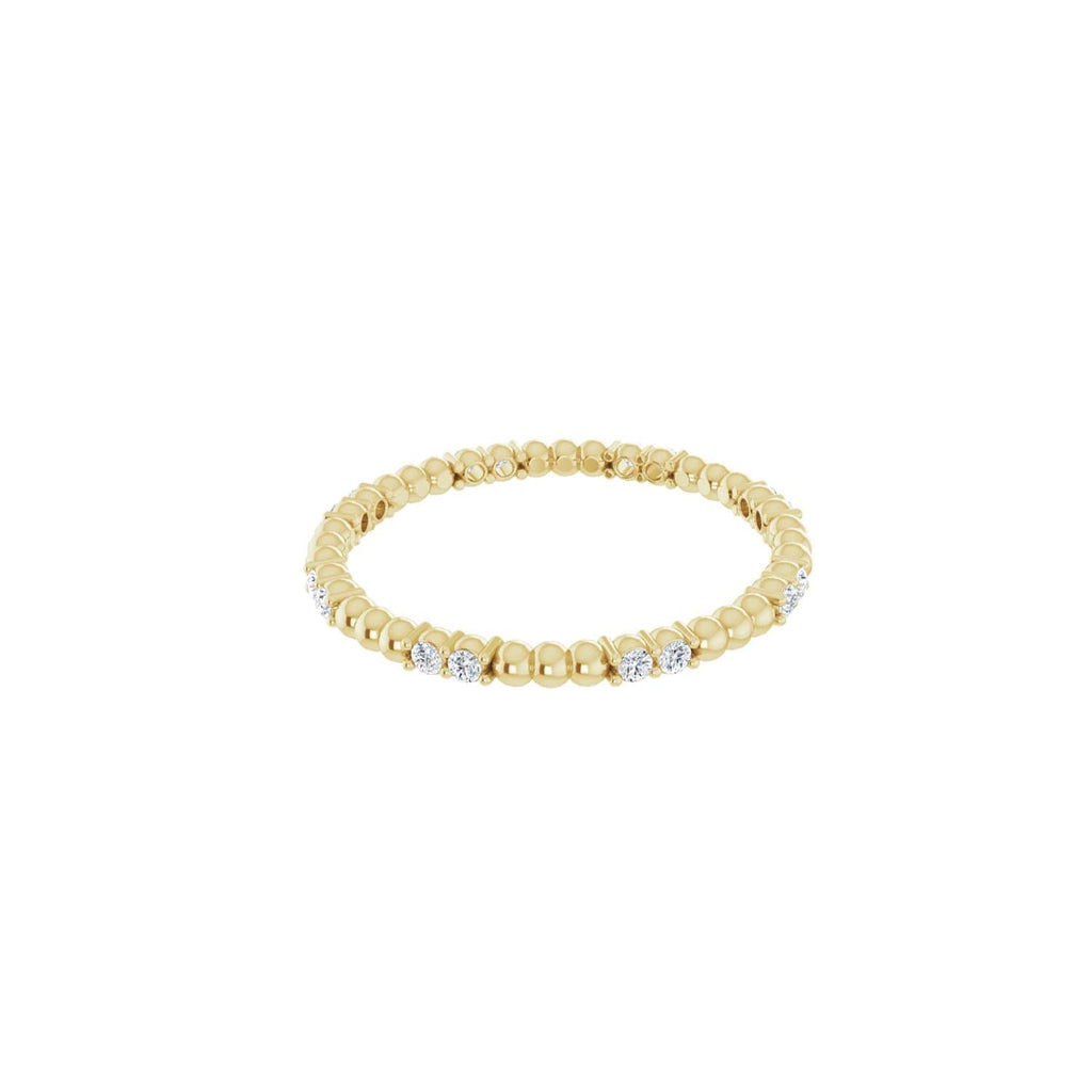 Diamond beaded eternity band in 14 karat gold
