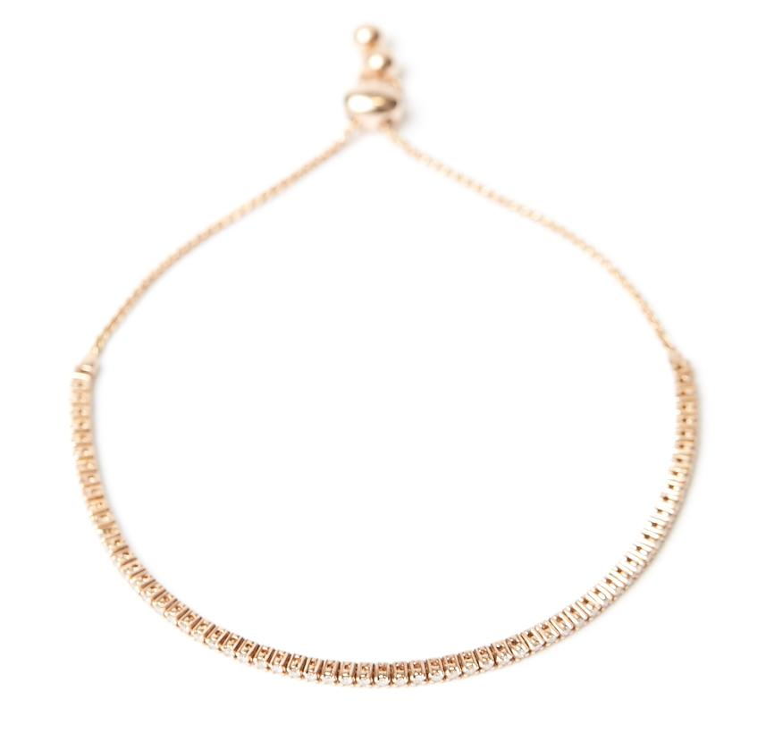 Diamond drawstring bracelet with adjustable length making it comfortable for everyday wear. 0.57 carats of diamonds and set in 14k (14 karat) yellow, rose or white gold.