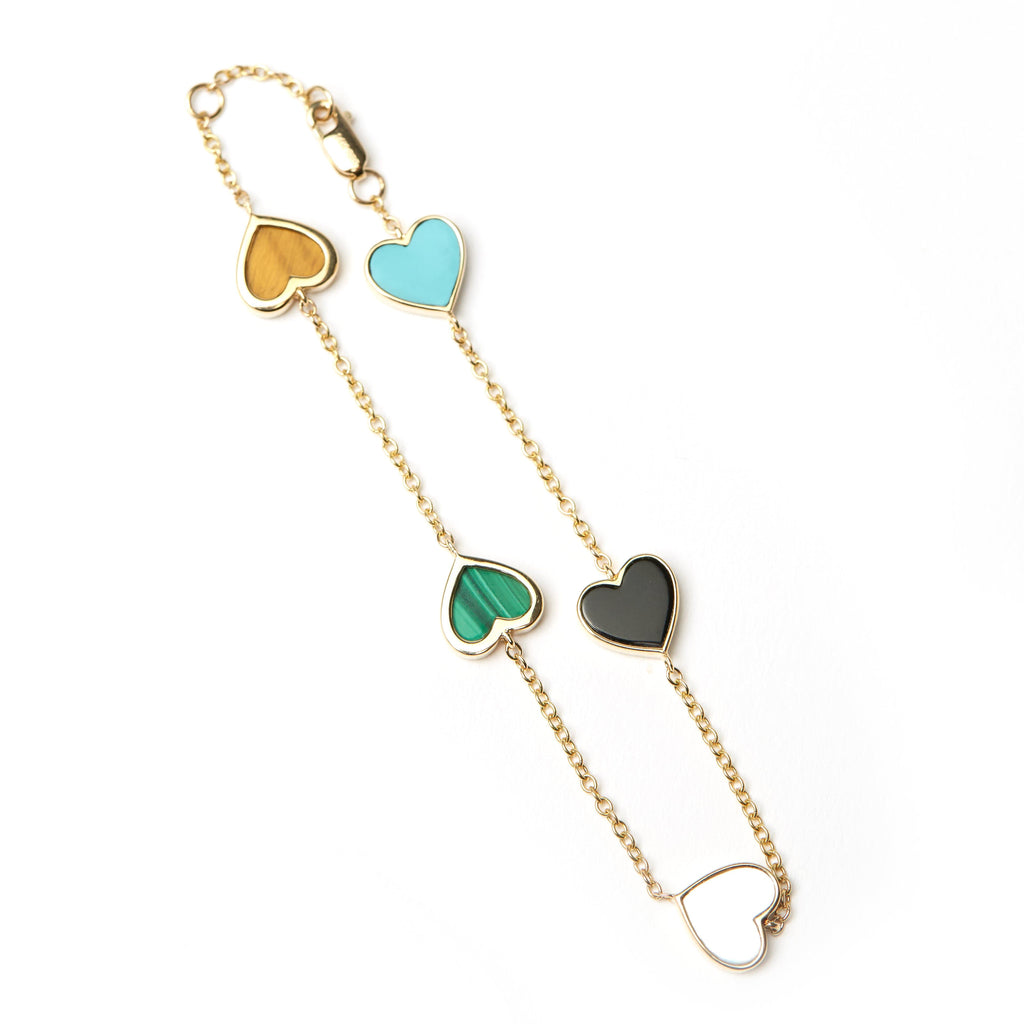 Five hearts bracelet with Turquoise, Onyx, Mother of Pearl, Malachite and Tigers Eye. Hand cut stones set in your choice of 14K gold.