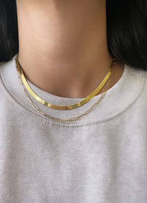 Herringbone gold chain necklace styled with gold paperclip necklace