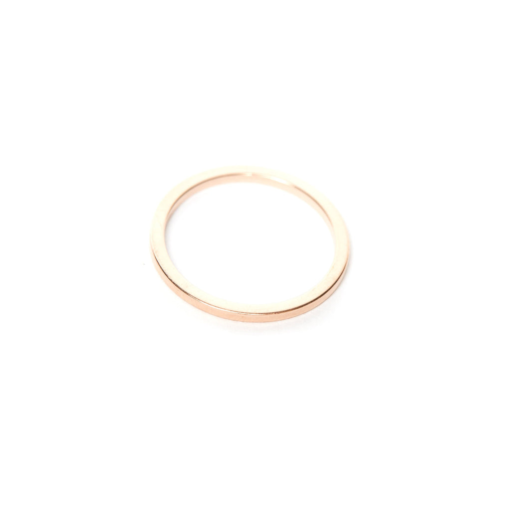 Skinny pinky ring in solid 14 karat gold