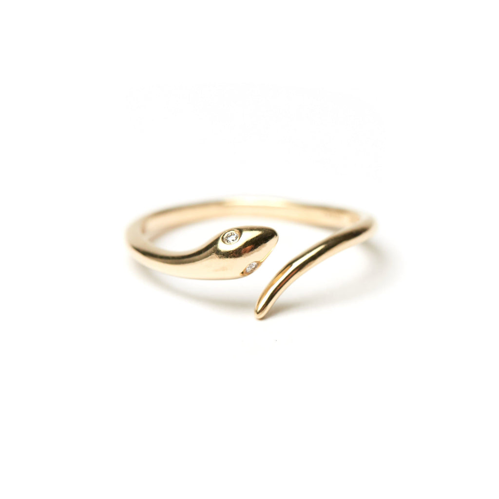 Snake ring in solid 14 karat gold with diamond eyes