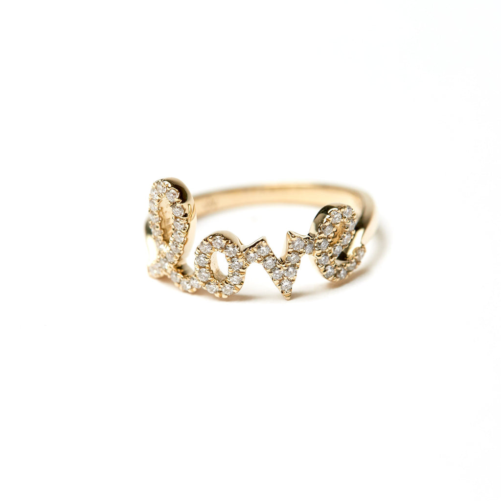 Diamond lower case love ring yellow gold