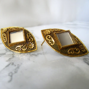 Beautiful lightweight gold mirror studs with side square shaped mirror in the middle. These earrings are perfect for all occasions including everyday wear, parties and even for work.