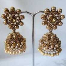 Load image into Gallery viewer, Beautiful statement gold flower jhumki earrings sure to make a statement at parties, weddings and any other special occasion. These earrings are the perfect touch of glamour to help you make a real statement.
