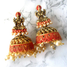 Load image into Gallery viewer, Gold and orange lakshmi earrings with faux pearl detail at the bottom. These statement earrings are perfect for everyday and special occasions.