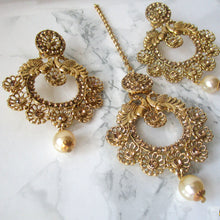 Load image into Gallery viewer, Beautiful gold detail tikka and earring set with faux pearls and peacocks to make the perfect statement at an event, party or special occasion.