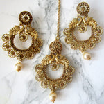 Beautiful gold detail tikka and earring set with faux pearls and peacocks to make the perfect statement at an event, party or special occasion.