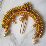 Stunning gold, faux emerald, ruby and pearl hair accessory designed to frame a bun or a ponytail. This is truly a statement piece to make you look a million pounds!