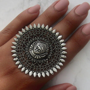 Very large adjustable silver ring with buddha face and intricate detail. This statement ring is lightweight and perfect for everyday and special events