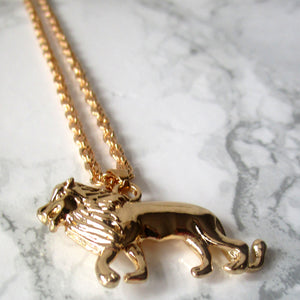 Inspired by the lion king, this simple long chain gold coloured necklace features a majestic male lion. Lovely statement piece.