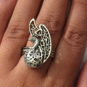 Detailed in shape and design. This ring has a beautiful peacock on the face. The ring is adjustable, and will fit all ring sizes. This ring is perfect for everyday or a special occasions.