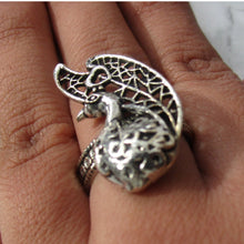 Load image into Gallery viewer, Detailed in shape and design. This ring has a beautiful peacock on the face. The ring is adjustable, and will fit all ring sizes. This ring is perfect for everyday or a special occasions.