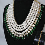 Faux Pearl and Green stone Necklace set with earrings and tikka. Perfect for all occasions.