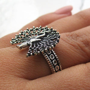 Detailed in shape and design. This gothic ring has a beautiful peacock with fanned out peacock feathers on the face. The ring is adjustable, and will fit all ring sizes. This ring is perfect for everyday or a special occasions.