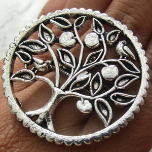 Silver coloured adjustable ring with a tree detail with fruit and birds on the face. This ring is adjustable and will fit all ring sizes. This is the perfect statement ring for everyday and special occasions.