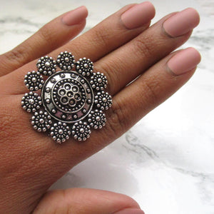 Adjustable silver ring with intricate design and detail. This statement ring is lightweight and perfect for everyday and special events