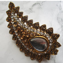 Load image into Gallery viewer, Beautiful gold and bronze paisley shaped brooch. This pin is perfect for blazers, jackets and as a saree pin. This brooch/pin is the perfect statement piece.