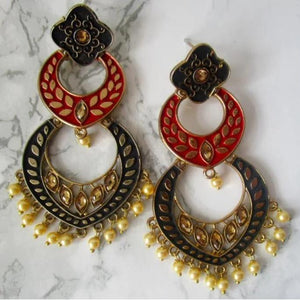 Beautiful statement earrings with black and red detail. These earrings have some stone detail and faux champagne colour pearls at the bottom