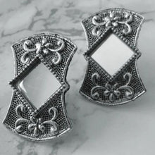 Load image into Gallery viewer, Detailed silver coloured studs with mirror in the middle. These earrings are perfect for all occasions.