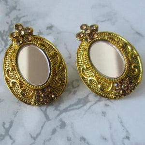 Beautiful and intricate lightweight gold mirror studs with oval shaped mirror in the middle. These earrings are perfect for all occasions including everyday wear, parties and even for work.