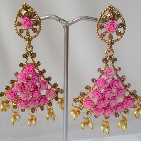 Gorgeous pink trumpet shaped drop earrings with faux pearl detail at the bottom and small pink roses in the earring itself. Beautiful statement earrings suitable for everyday or special occasions.