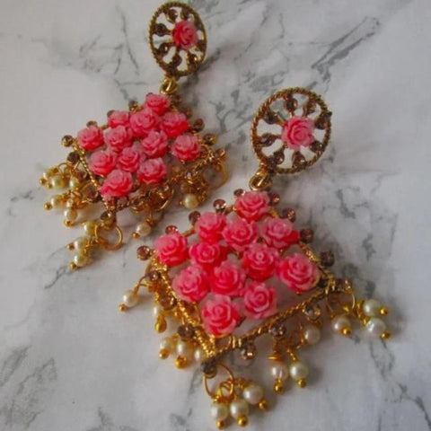 Gorgeous red diamond shaped drop earrings with faux pearl detail at the bottom and small red roses in the earring itself. Beautiful statement earrings suitable for everyday or special occasions.