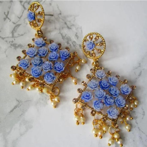 Gorgeous blue diamond shaped drop earrings with faux pearl detail at the bottom and small blue roses in the earring itself. Beautiful statement earrings suitable for everyday or special occasions.