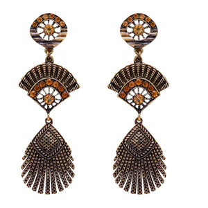 Beautiful statement earrings with a circle detail at the top, followed by a fan detail and then a peacock feather detail. These earrings are all metal and bronze in colour. Perfect for everyday or a special occasion.