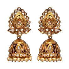 Load image into Gallery viewer, Beautiful statement gold leaf-like jhumki earrings sure to make a statement at parties, weddings and any other special occasion. These earrings are the perfect touch of glamour to help you make a real statement.