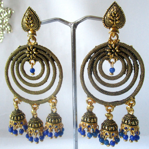 Spiral Gold Earrings with blue detail. Perfect for making a statement on all occasions