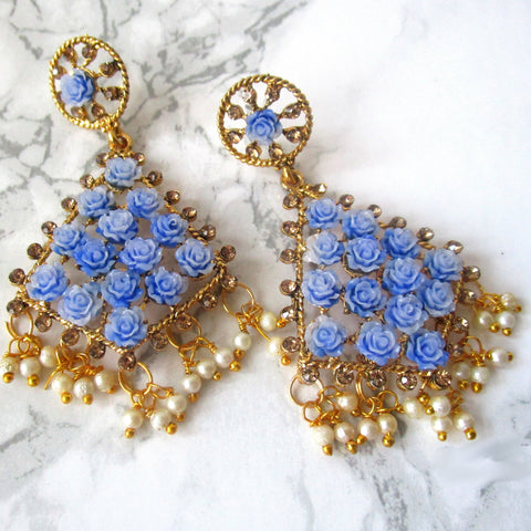 Gorgeous blue kite shaped drop earrings with faux pearl detail at the bottom and small blue roses in the earring itself. Beautiful statement earrings suitable for everyday or special occasions.