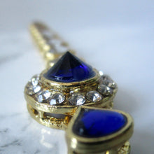 Load image into Gallery viewer, Simple Blue Tikka with gold metal and stone detail
