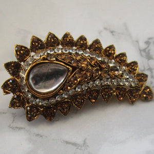 Beautiful gold and bronze paisley shaped brooch. This pin is perfect for blazers, jackets and as a saree pin. This brooch/pin is the perfect statement piece.