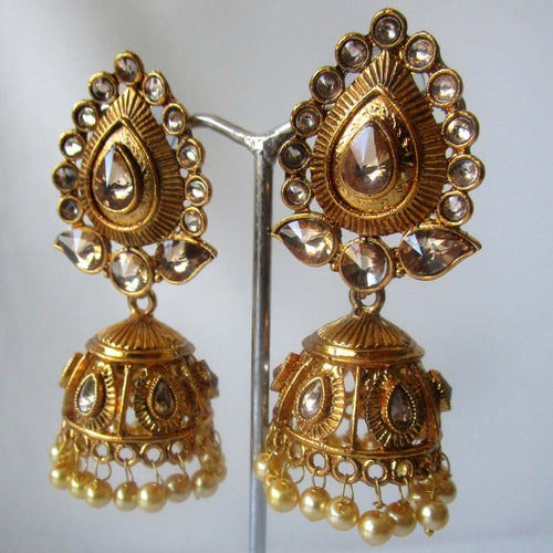Beautiful statement gold leaf-like jhumki earrings sure to make a statement at parties, weddings and any other special occasion. These earrings are the perfect touch of glamour to help you make a real statement.