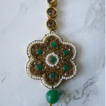 Load image into Gallery viewer, Gold and green large flower tikka with faux pearl detail. This statement piece is perfect for special occasions and parties.
