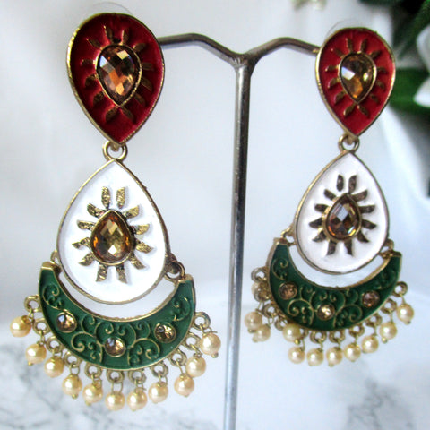 Red, white and green dangle earrings with faux pearl detail. These earrings are perfect for evening events and special occasions.