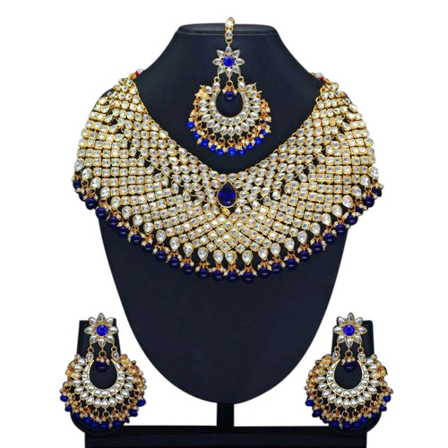 Gold plated gold and royal blue full set with necklace, earrings and tikka. This set is perfect for weddings, parties and special occasions. This is the perfect statement piece.