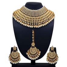 Load image into Gallery viewer, Beautiful heavy gold necklace set with matching earrings and tikka - perfect for brides and anybody who wants to feel totally regal! Perfect statement piece available with white, green or red detailing.